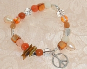 SUMMER ORANGE STRETCH BRACELET W/ PEACE SIGN