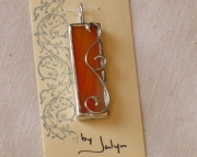 Stained glass scroll pendant, orange