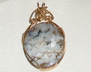 Brazialian Agate Gemstone Pendant wrapped in 14k Gold wire.