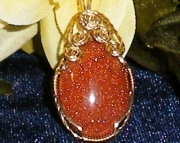 Handmade Gold Stone cabochon pendant wrapped in 14k Gold wire