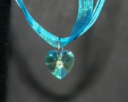 Clear crystal heart on teal organza ribbon