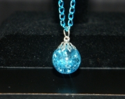 Light azure stone on blue chain necklace