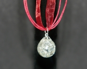 Clear stone on maroon organza ribbon