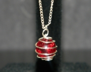 Ruby Red stone on silver chain with silver wire wrapped