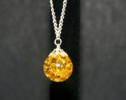 Yellow stone on silver chain necklacee