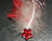 Red and white feather barrette