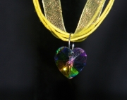 Multi colored crystal heart on yellow organza ribbon
