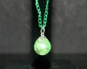 Green cat eye stone on green chain necklace