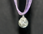 Clear stone on purple organza ribbon