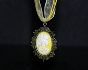 Yellow lady skull pendant on yellow organza ribbon