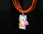 Hello Kitty charm on orange organza riboon