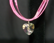 Pink crystal heart on hot pink organza
