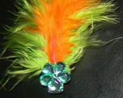Green and orange feather barrette.