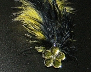 Yellow and black feather barrette