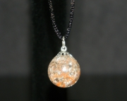 Orange and white swirl stone on black nylon necklace