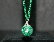 Teal stone on green chain neckace