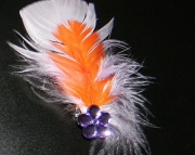 Purple and orange feather barrette