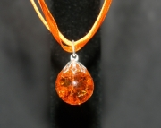Orange stone on orange organza ribbon