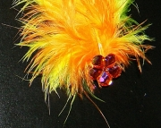 Orange and yellow feather barrette