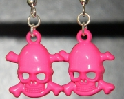 Pink plastic skull earrings