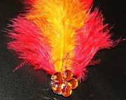 Red and orange feather barrette