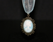 Blue lady skull pendant on light blue organza ribbon