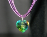 Multi colored crystal heart on dark purple organza ribbon