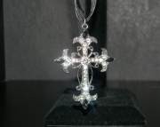 Silver cross with rhinestone necklace on black organza ribbon