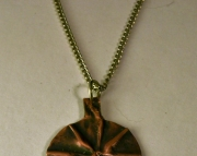 Circular Copper Pendant On Metal Necklace