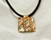 Copper pendant on fiber necklace