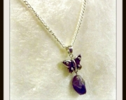 Purple stone with butterfly pendant