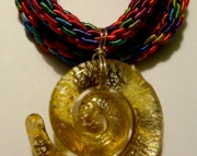 Glass Yellow Spiral Pendant On Pink, Yellow, and Aqua Blue Kumihimo Braid