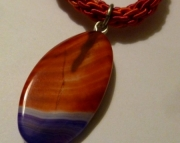 Red and Purple Stone Pendant on Bright Red, Pink, and Green Kumihimo Braid
