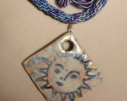 Handmade Pottery Pendant on Blue and Violet Kumihimo Braid