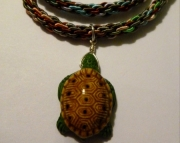 Ceramic Turtle Pendant on Multi-color Kumihimo