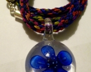 Blue Flower Glass Pendant on Bright Rainbow Kumihimo Braid