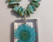 Aqua Blue Genuine Flower in Resin and Mother of Pearl and Leather Necklace