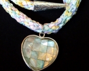 Faceted Mother of Pearl Heart Pendant On Light Pastel Rainbow Braid