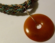 Orange Carnelian Gemstone Pendant on Brown, Blue, and Green Kumihimo Braid