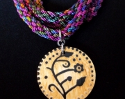 Wooden Flower Pendant on Rainbow Braid