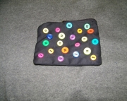 Black bag with scattered buttons