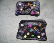 Black velvet bag with flower cluster