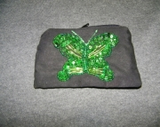 Black bag with green butterfly