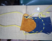 navy and gold fringed medicine pouch