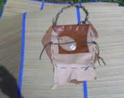 toupe and tan leather medicine pouch