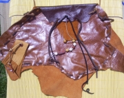 gold and brown leather medicine shoulder pouch