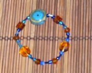 turquoise and amber colored glass bead bracelet