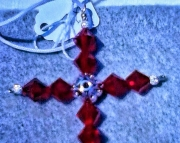 Red Swarovski and Silver Filigree Cross Pendant On White Satin Cord