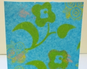 Handmade card with cheerful yellow flowers floating on turquoise painted tissue. Perfect for birthda
