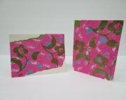 Handmade greeting card with bold metallic green flowers floating on pink tissue Birthday